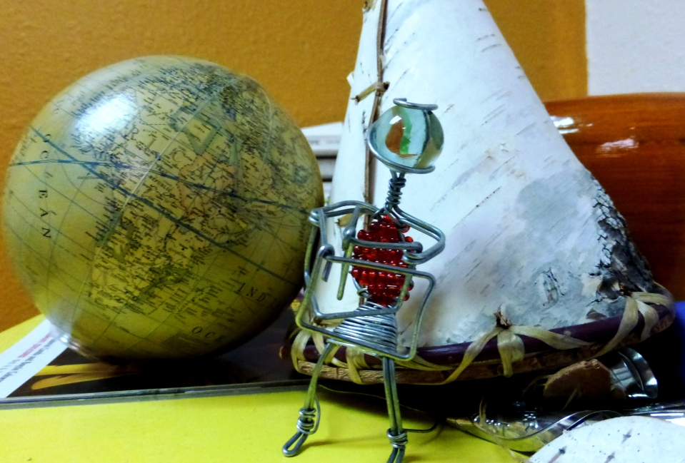A globe from Susanna, a tepee from Kristine, and beach person from Jonathan Khumbulani Nkala. All good omens for travelers.