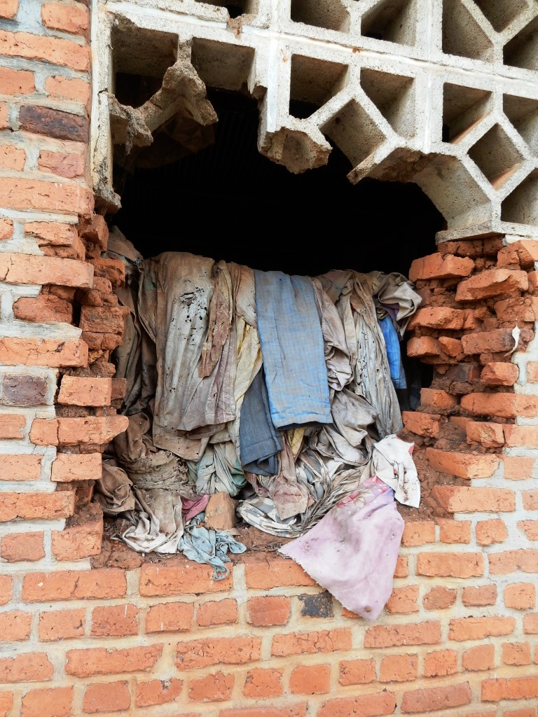 These clothes just hang here, now for twenty years, as it rains, and heats and cools and dust settles. The blood washed away, still stained though.