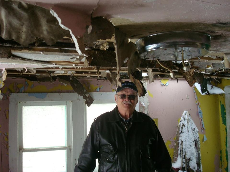 Robert, among the festive ceiling hangings.