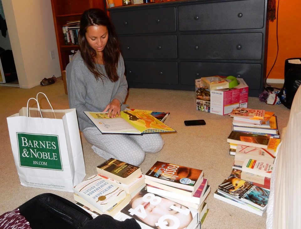 Proof Teresa's my granddaughter. Sorting books as she prepares to move home and then San Francisco.