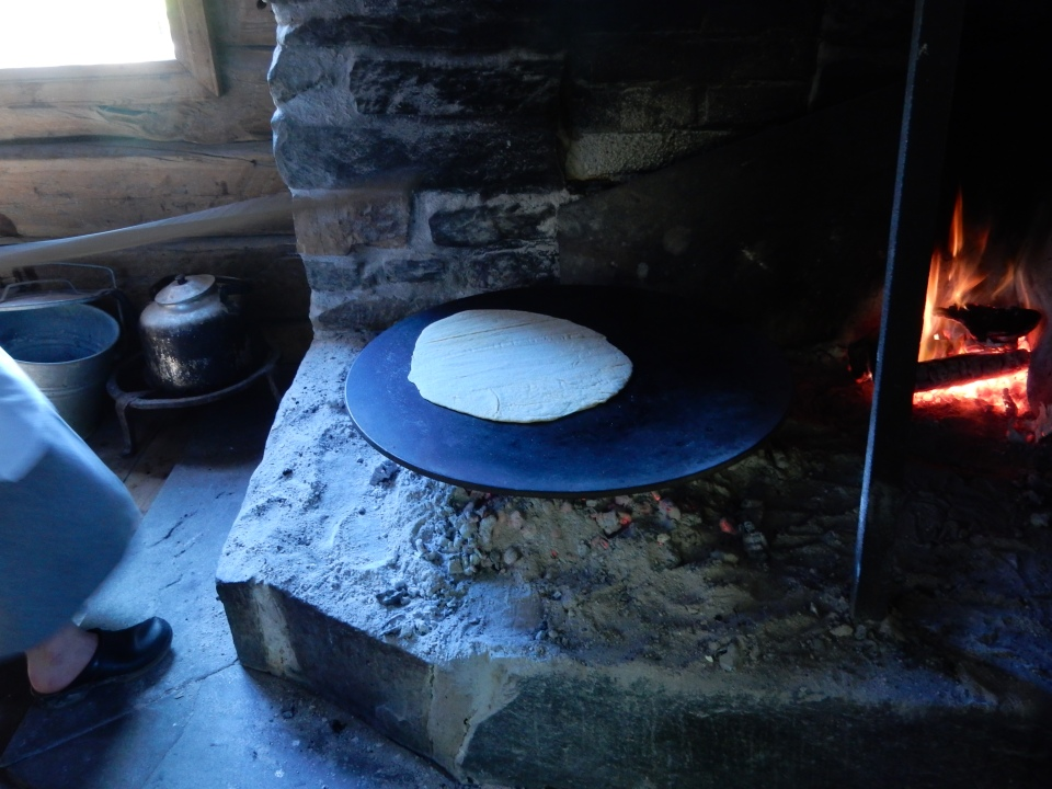 MAKING LEFSE AT A MUSEUM-FARM OF TRADITIONAL NORWEGIAN LIFE IN OSLO.